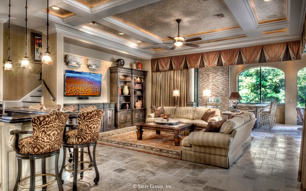 the leisure room has a detailed tray ceiling and access to the outdoor kitchen - The Outdoor Room